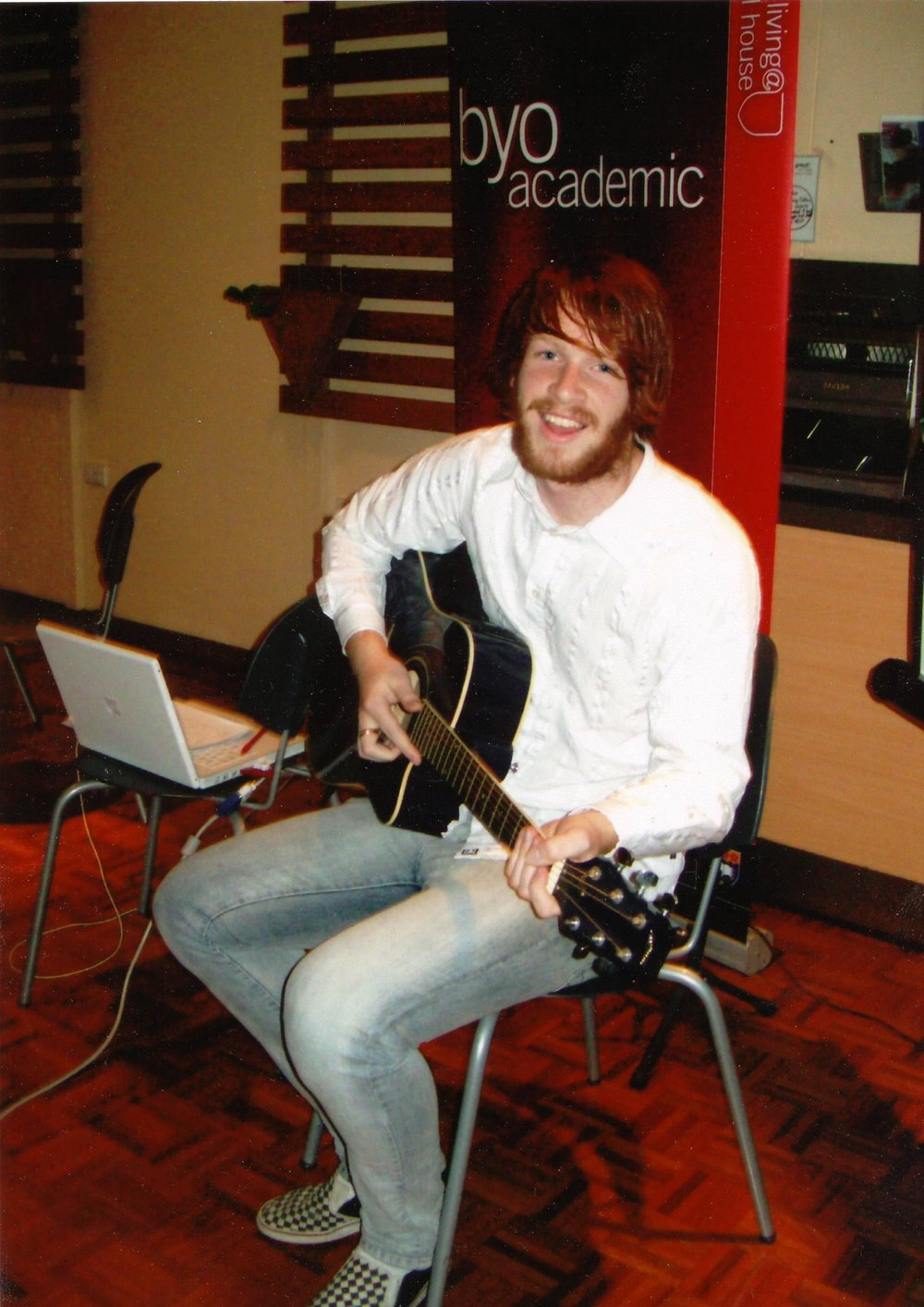 Playing guitar at an event at uni back in 2009