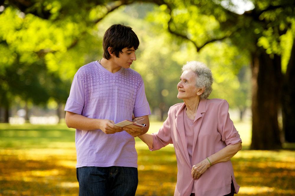 young-man-elderly-woman-visiting-1080937-print.jpg