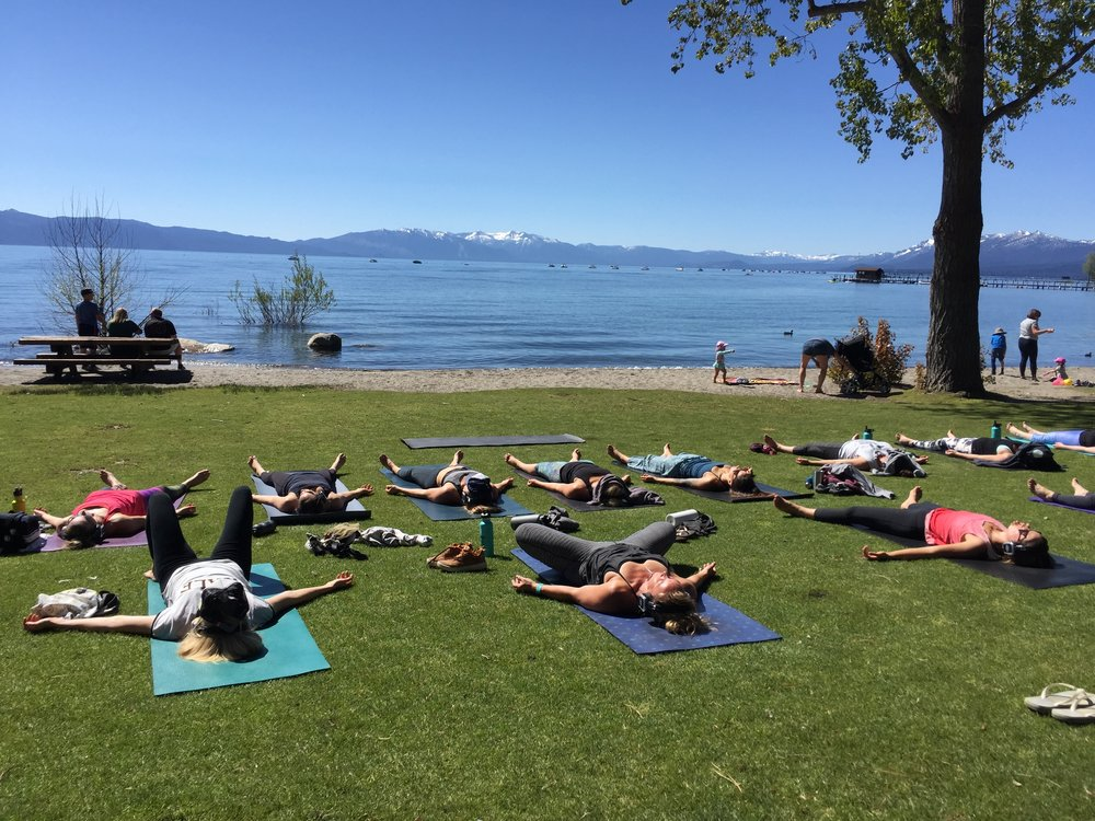 Are you ready for the yoga experience of a lifetime? - Silent Disco Yoga on Lake Tahoe is the yoga experience of a lifetime. We gather in one of the most beautiful places in the world, on Commons Beach in Tahoe City, CA. Every Wednesday and Saturday morning from 9-10:15 am we move, we breathe, we listen, and we acknowledge the life process.There are a few different ways to sign up for classes; through the  Mind Body App , EventBrite, and AirBnb Experiences. These platforms give you the freedom to choose what payment method works best for you. You can also simply show up at class and register as well. However, we highly recommend you register in advance to save yourself a space in class.Once you have registered for a class, or classes, you will receive a detailed email answering most of the common questions associated with logistics, and insights. All of us here at Silent Motion are grateful you took the time to visit our website. We hope you join us in the magic of Lake Tahoe for some truly epic yoga. Om. Namaste.