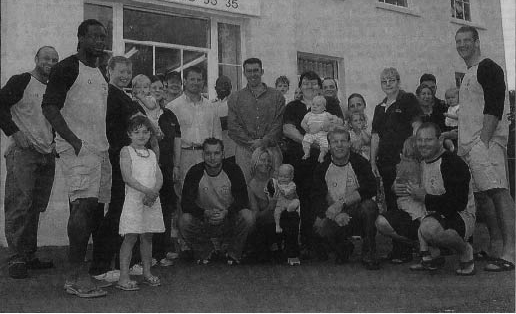 Jim Jenner (centre) with the area manager Helen Smith (centre right) and some of the Worcester Warriors at the opening of the 1st nursery in 2002
