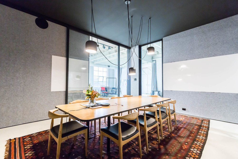 """Boardroom - 4 Brunswick Place - The Boardroom at 4 Brunswick Place conformably seats 10-12. A 65"""" OLED TV with Apple TV also available for presentations.$600 per day ($100 per hour)"""