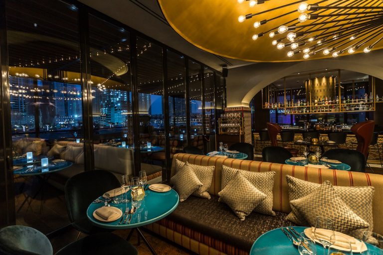 The main dining area (love those turquoise tabletops!) (credit: Ruya)