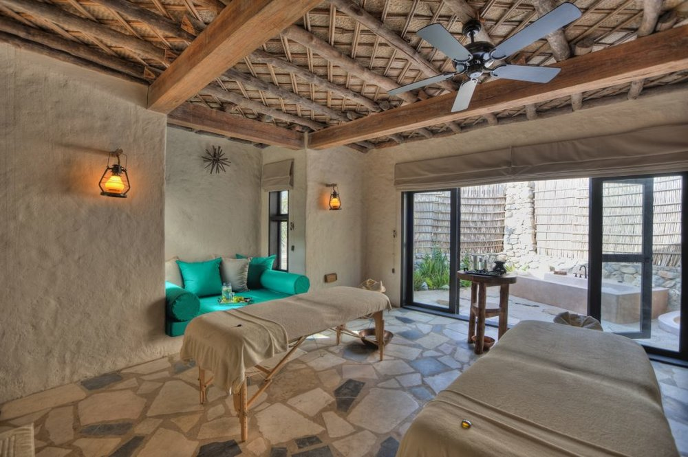 The lush spa treatment room (photo credit: Six Senses Zighy Bay)
