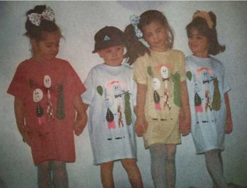 Gabriella, her sisters, and a friend, wearing her mother's designs back in the day!