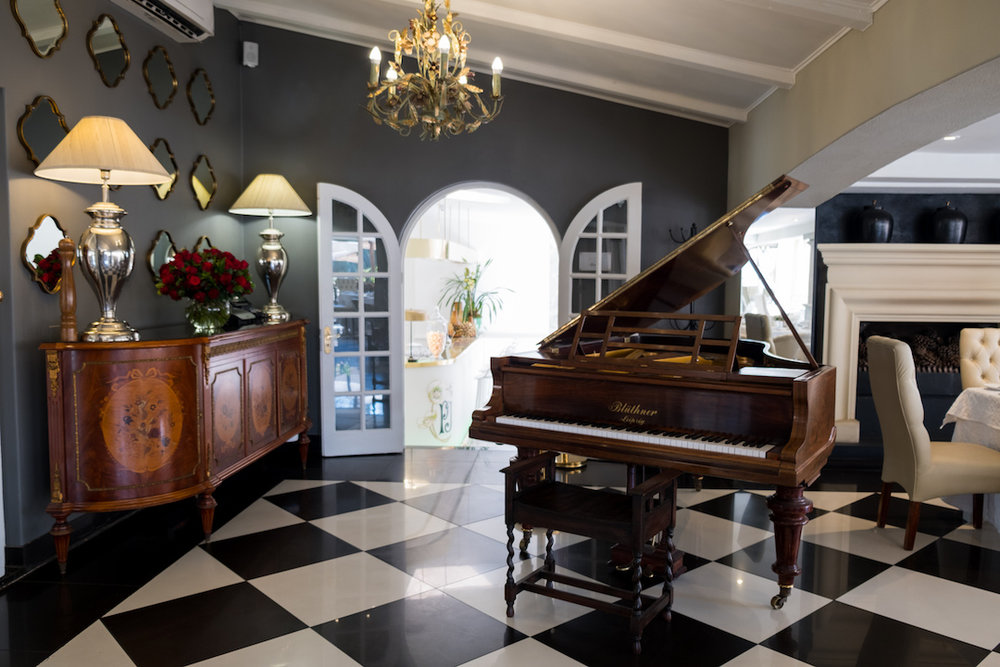 The open dining room has a piano at the entrance and Muse Champagne Room is just through that arched doorway (photo supplied)