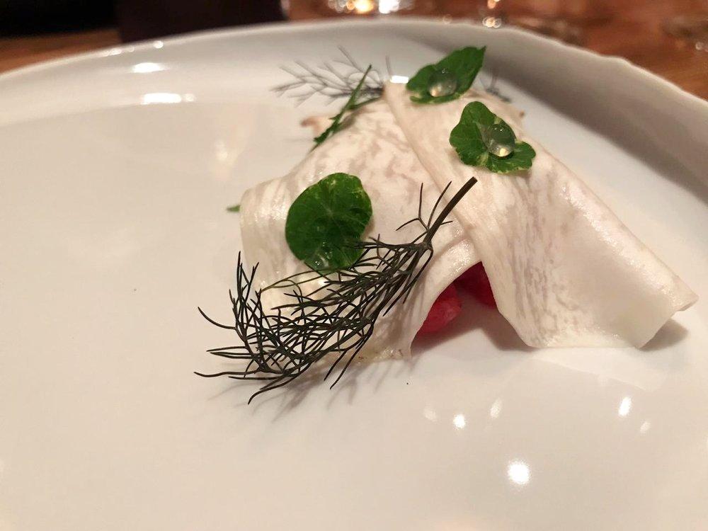 Tartare of bluefin tuna otoro, pickled mushroom shavings, and nasturtium