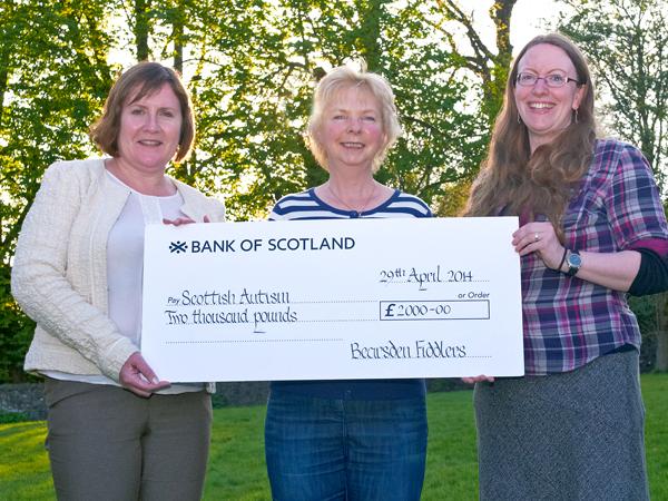 2014-04-29 Amelia presents cheque to Scottish Autism representatives at AGM.jpg