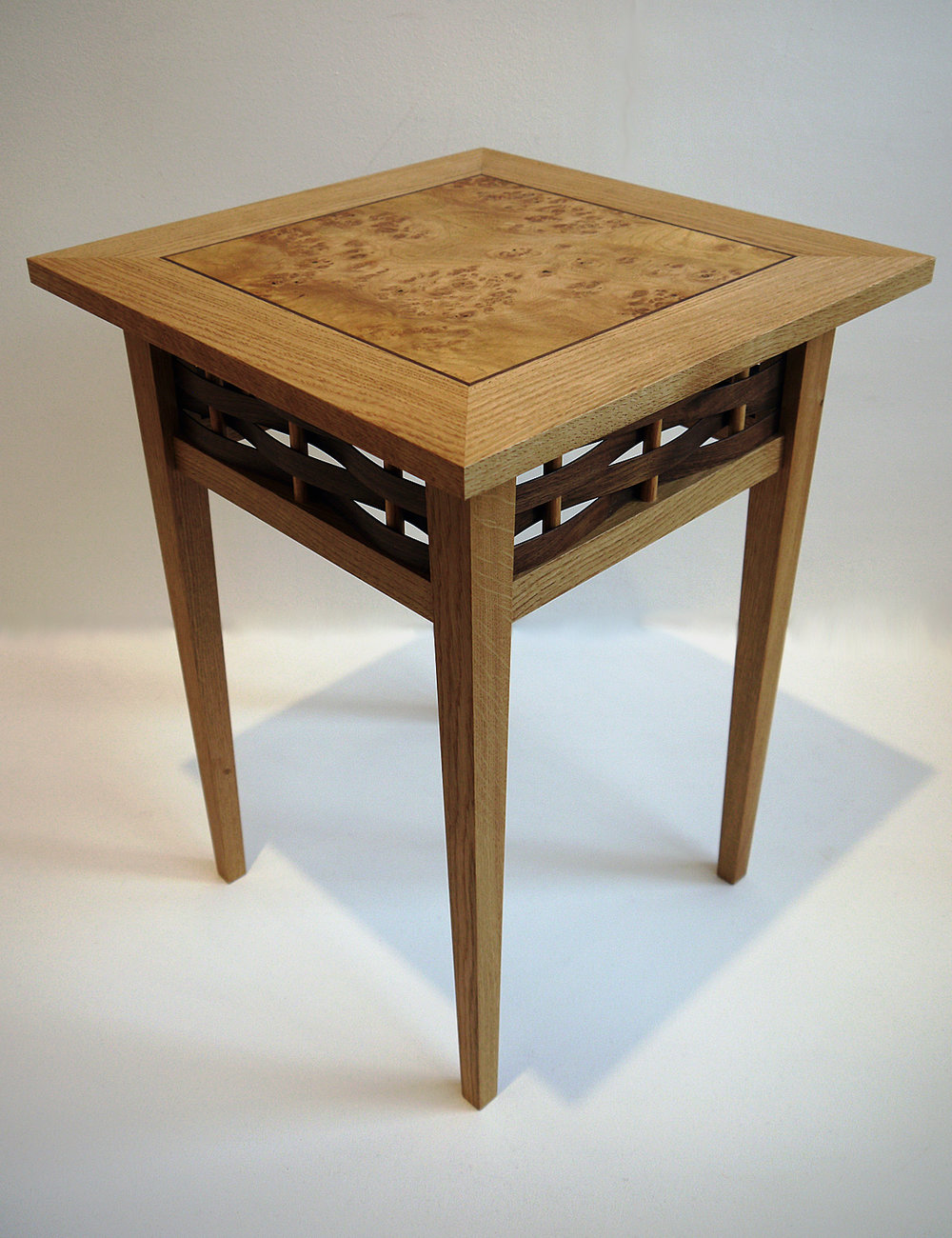 Watul side tables - Wattle, or watul in old English, hurdles date back over 6000 years and are fencing panels woven from coppiced round wood timber. I learned to construct them in the traditional way from my father and have now taken them as inspiration for my 'Watul' range of furniture.These four oak side tables, with different veneer tops, demonstrate the subtle variations that are possible when commissioning me and how they can change the style of a piece. I am always happy to guide you through these options to create the perfect piece for you to own and treasure for years to come.Dimensions: Height 45cm, width 60cm, depth 60cm Price: £950