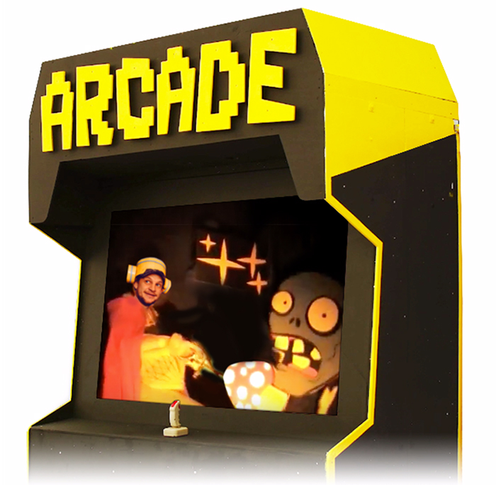 A giant arcade machine where you control real-life players in a voice activated side-scrolling arcade-adventure! Also serves as a stage for a wide variety of video game themed events.
