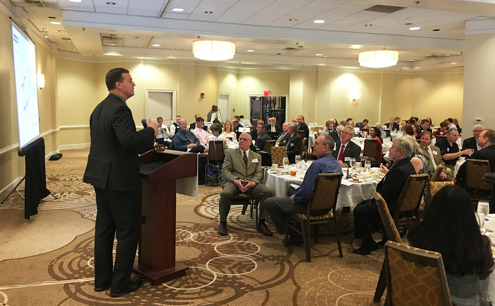 "At TCRPC's May 2018 luncheon, national expert on automated and ""connected"" vehicles Matt Smith (left), of Michael Baker International, previewed what local governments and communities can expect when driverless cars and trucks take to the roads in the future."