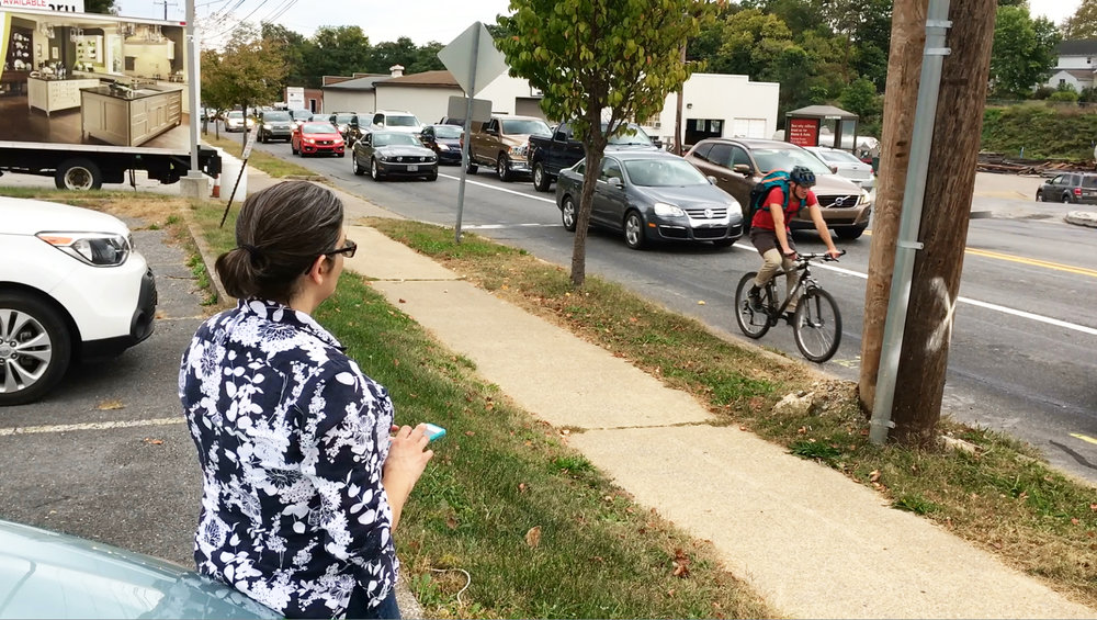 Volunteer Diana Sheppard records the number of bicyclists and pedestrians traveling through the intersection of 3rd & Market streets in Lemoyne during an October 2017 rush hour.