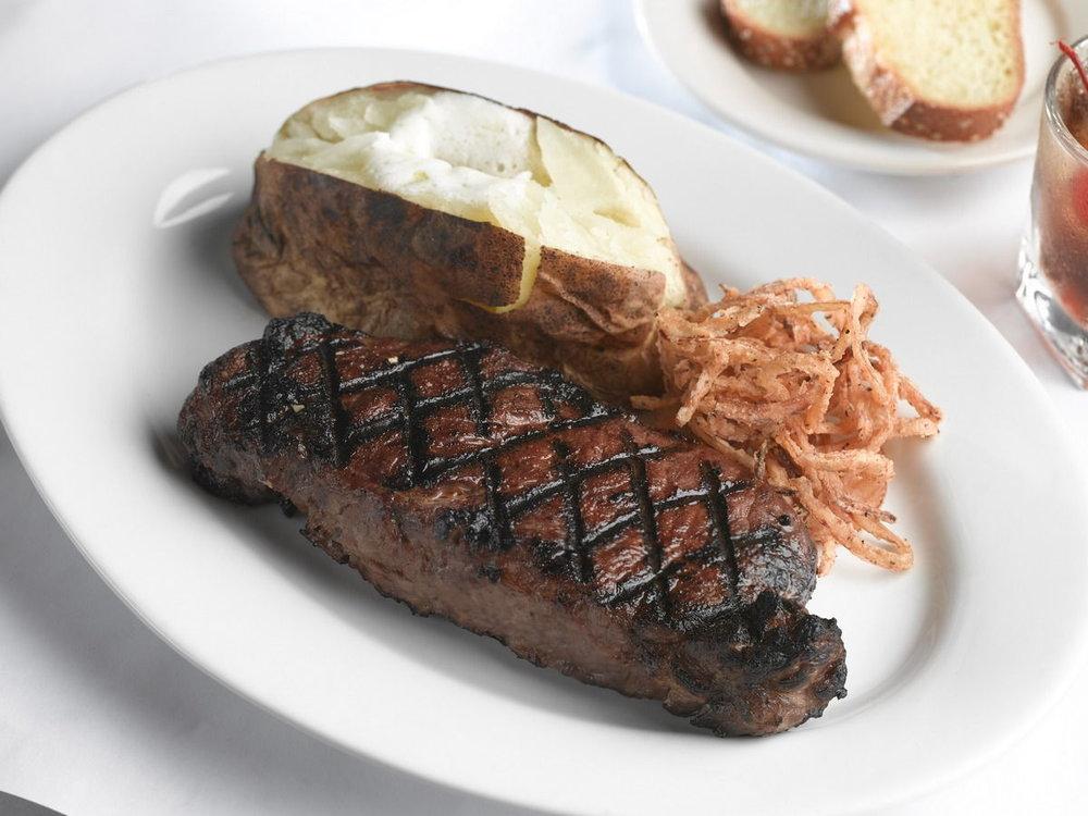 A photo of a steak entree.