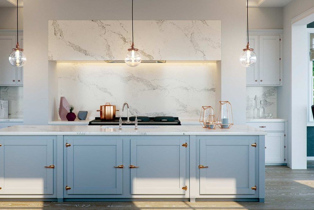 Caesarstone white and grey marble work surface with baby blue kitchen doors and copper highlights.