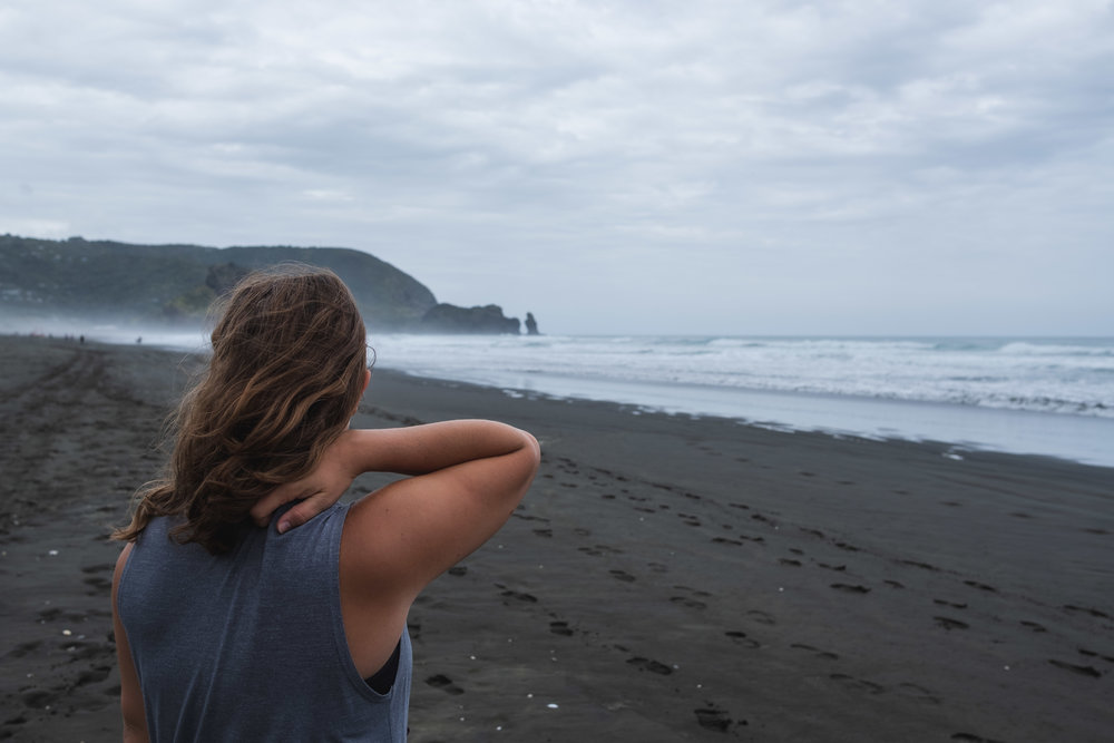 flexing at the black sand beach