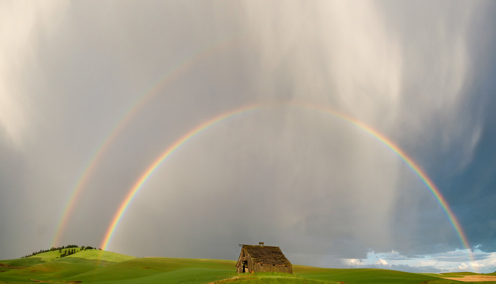 Double rainbows over a barn near Ladow Butte, WA