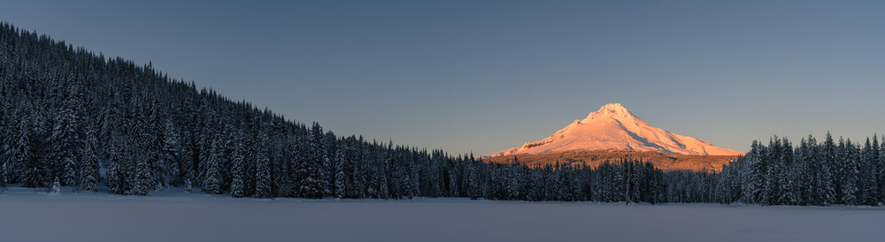 Sunset on Mount Hood, from the middle of a frozen Trillium Lake, OR.