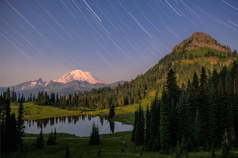 A full-moon timelapse of the night sky above Tipsoo Lake, Mount Rainier, and Yakima Peak.