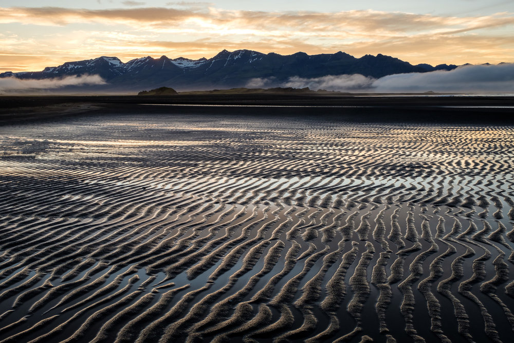 Sandy ripples and mountains on the Laekjavik coast