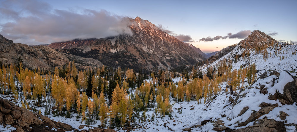 Fresh snow, golden larches, and evening light on Mount Stuart from below Ingalls Pass.