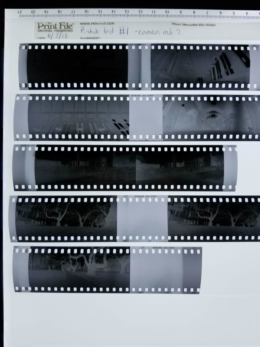 The first roll of film on my light table. Notice the light leaks and fogging visible between frames.