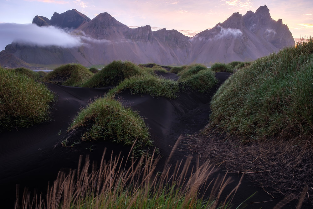 Sand dunes at Stokknses and the famous Vesturhorn mountain at sunrise.