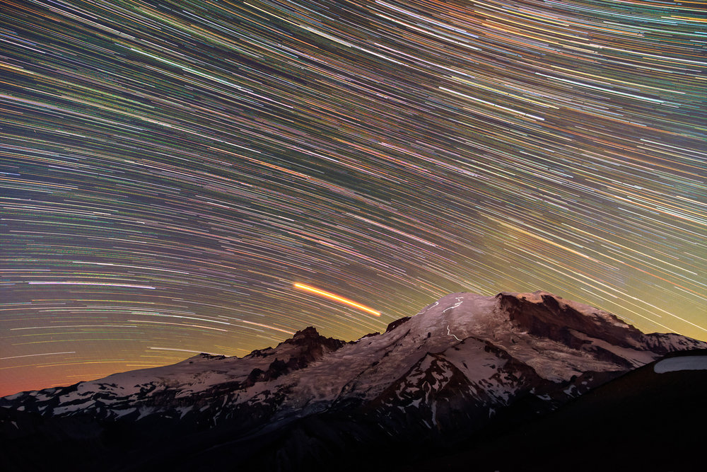 Climbers on the Dissapointment Cleaver and Emmons-Winthrop Routes are visible in this 2 hour star trail exposure.