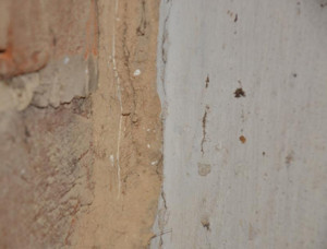 The thin white line seen above that is embedded in between two layers of plastering is actually a cross-section of a layer of original wall paint.