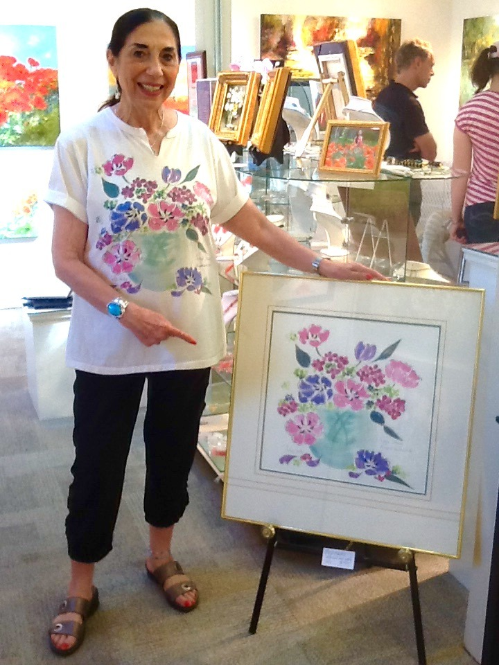 Angie Strauss matches her painting today! 'Tulip Smiles' is one of Angie's vintage original paintings from 1988 that was NFS until today. The painting was an original design for Angie's clothing line in the 80's and 90's. Angie just happened to be wearing the t-shirt today! 'Tulip Smiles' 25x26 with frame $595