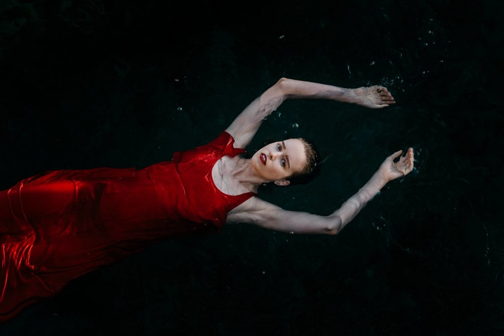"This image was created by Tarynn Jade Walker and it is entirely entrancing. We would love to share her words and description with you all, ""I had this red silk dress in my wardrobe and I had a vision for this project in a dream. We went down to the sea at first light and I shot from the cliff above with a long lens. I'm always so much happier with the results when I can follow an idea in my head and experiment without the expectations of a ""paying"" client. If only I didn't need to make money."" Amen to that Tarynn, beautiful work!"