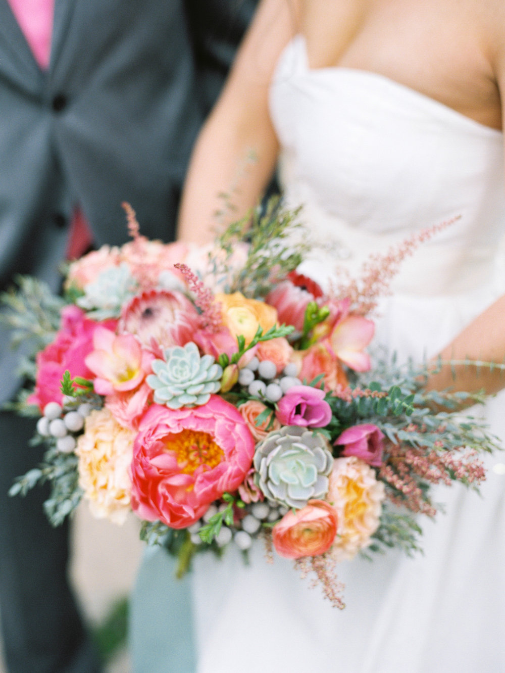 Photography -  Michael and Anna Costa   Coral Charm Peony - Winter/Spring  Peach Campanella Garden Rose - Year Round  Peach Ranunculus - Spring  Silver Brunia - Year Round  Echeveria Lola Succulents - Year Round  Pink Astilbe - Year Round  Pink Ice Protea - Year Round  Pink Freesia - Year Round
