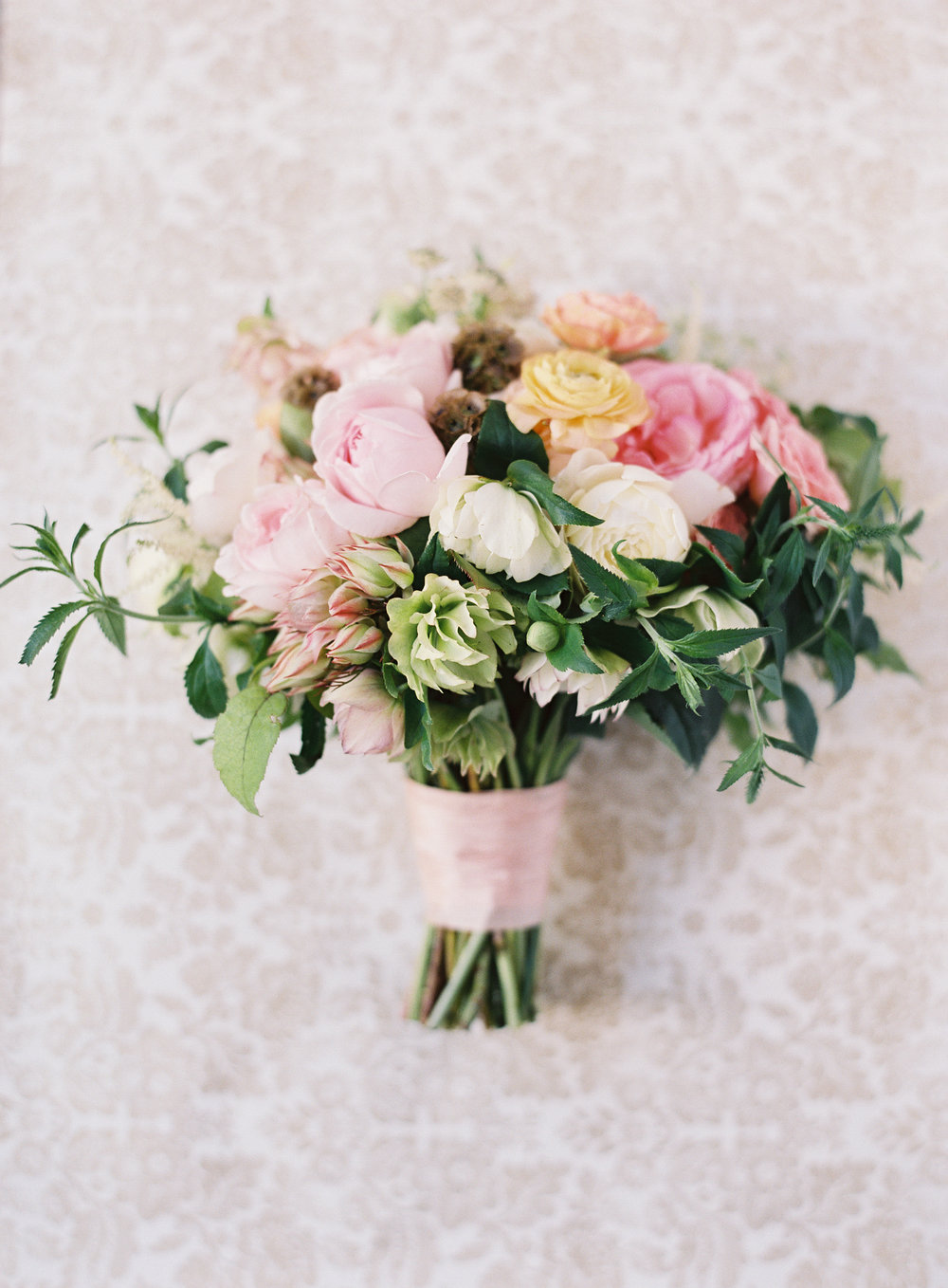 Photography -  Michelle Beller Photography   Green/White Hellebores - Spring/Winter  Blushing Bride Protea - Summer  Brown Scabiosa Pods - Spring/Summer  Pink Heritage Garden Rose - Spring/Summer/Fall  Peach Ranunculus - Spring