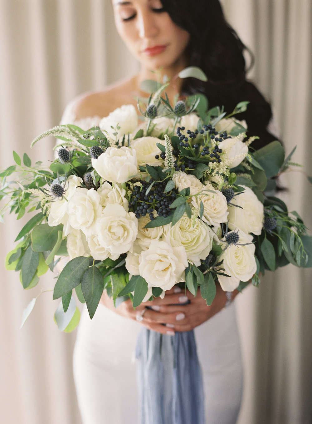 Photography -  Linda Chaja Photography   White Alabaster Garden Rose - Year Round  White Majolika Spray Rose - Year Round  White Astilbe - Year Round  White Double Tulip - Spring/Summer/Winter  White Veronica - Year Round  Blue Eryngium - Year Round  Navy Privet Berries - Fall/Winter