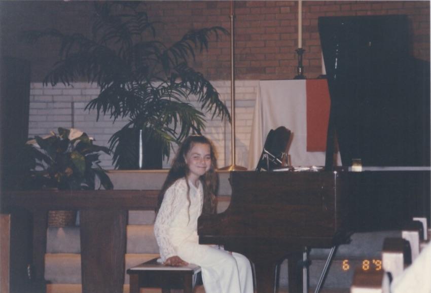 Young Alicia Pyle practicing piano