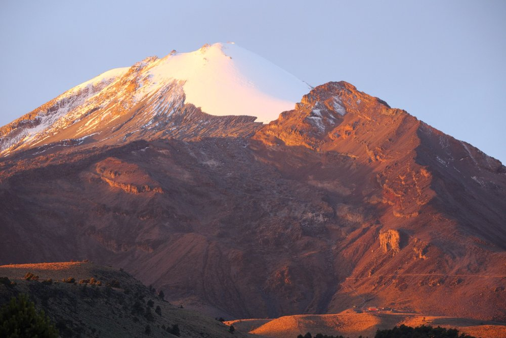 A clear sky giving us our first glimpse of Pico De Orizaba. Summit elevation 5,640 meters/18,500 feet.