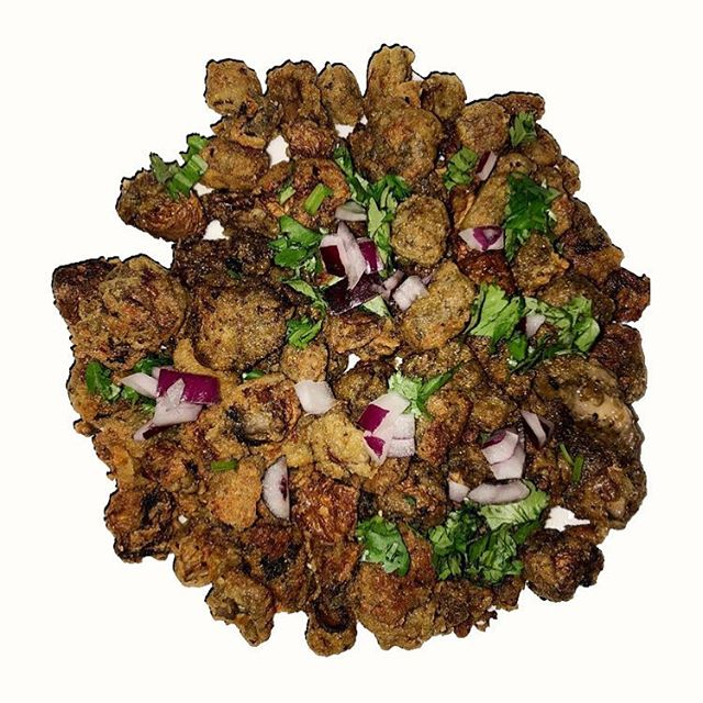 """'Mushkens' are a cross between mushrooms and """"chicken"""" given that these deliciously fried poppers are plant based and have not one bit of chicken in them-they have the texture of a fried chicken popper. Sautéed and fried in grape-seed oil, the bite of a Mushken is filling, yet leaves one feeling energized and satisfied."""