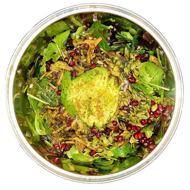 Sweet & Sour Pom Salad by Mother & Chef @sophiakapri Pumpkin seeds, pomegranate seeds, sautéed shimeji mushrooms, avocados, moringa powder, african bird pepper, spring mix greens, mct coconut oil, pink salt, & lime.