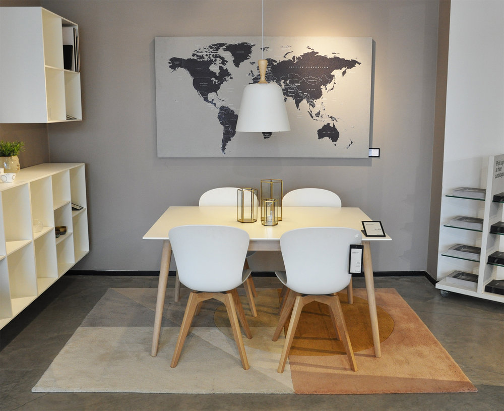 Milano table ,  Adelaide chairs ,  Adana rug ,  Handle Me pendant ,  Hexagon lanterns ,  World Map Concrete Art .