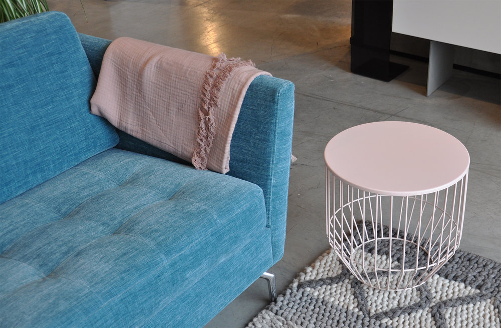 Osaka sofa  in turquoise Napoli fabric,  Palencia rug ,  Wire stool  in matt pink.
