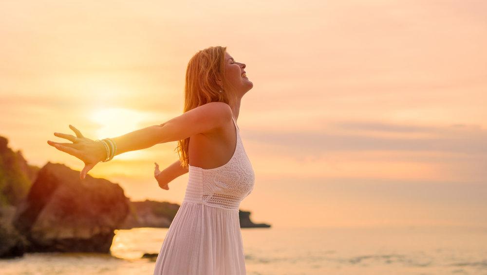 elated woman on beach