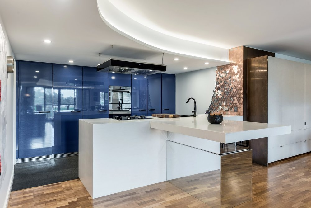 This blue kitchen won the KBDI NSW kitchen designer of the year award 2017, and NSW large kitchen of the year 2017.  Courtesy of Greg Scott