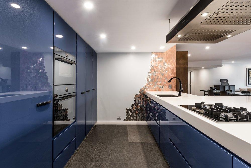 "This ""Blue kitchen"" was designed by Marianne Gailer.  Courtesy of Greg Scott"