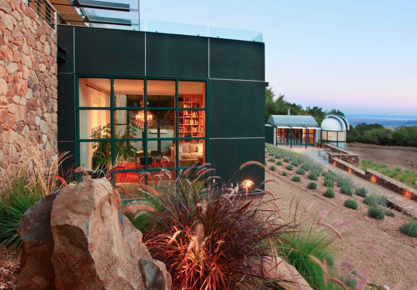 The rich green tone pairs well with warm earthy shades, as shown in this contemporary home's exterior. Image: JMA