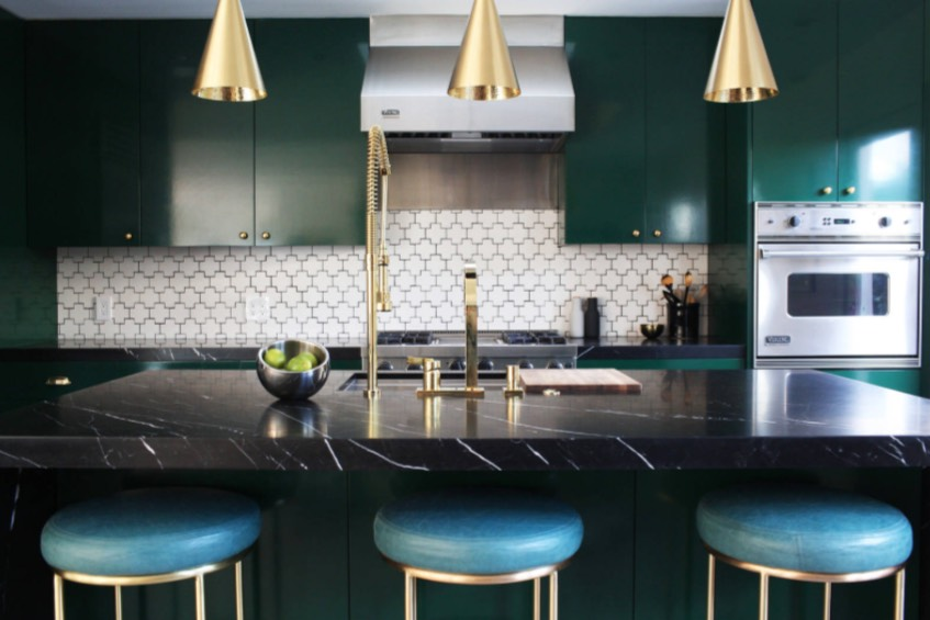 Pair the luxurious dark green tone with gold metallic finishes. Image: Black Lacquer Design