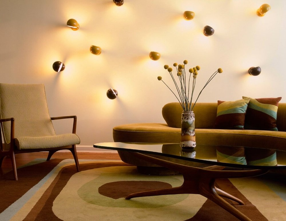 Turning wall lighting in unexpected directions gives an instant look of funky fun. Image: Amy Lau Design