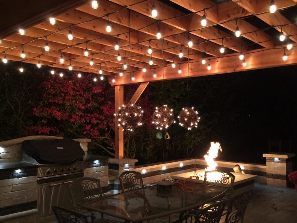String lights also add ambient light when strung around hanging rustic pieces. Image: PaveStone Brick Paving