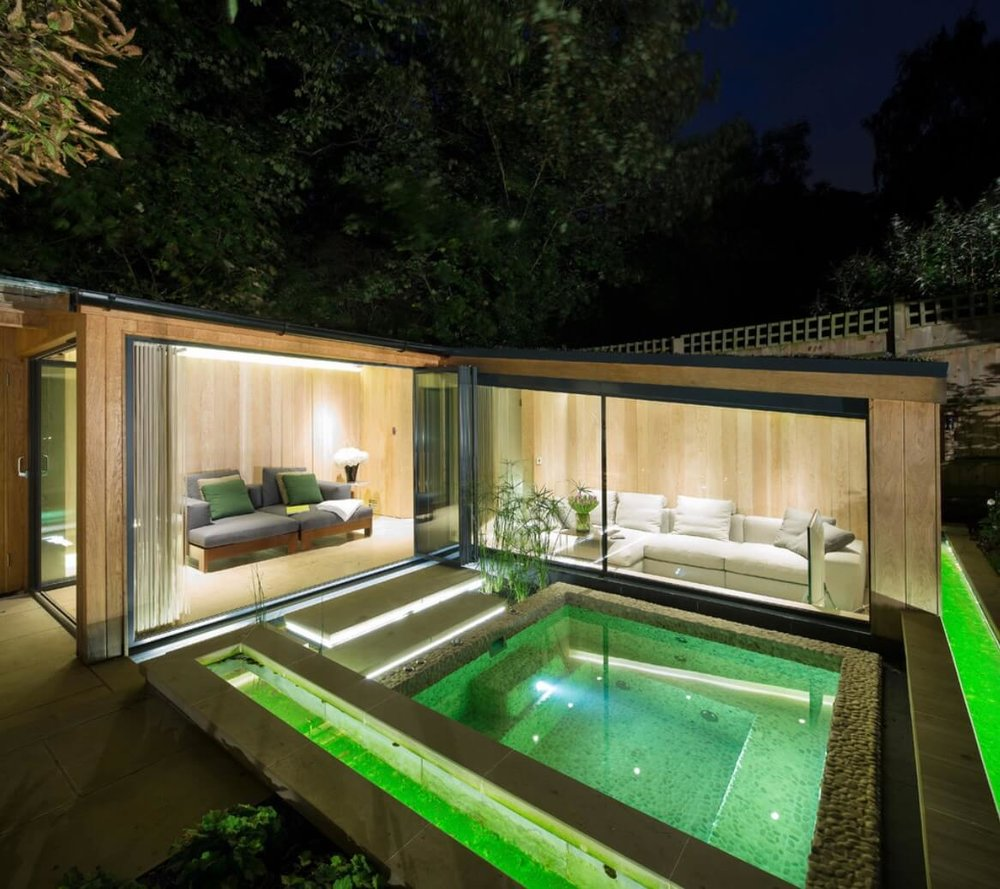 Colored lighting adds style and interest to a pool or hot tub. Image: Folio Design
