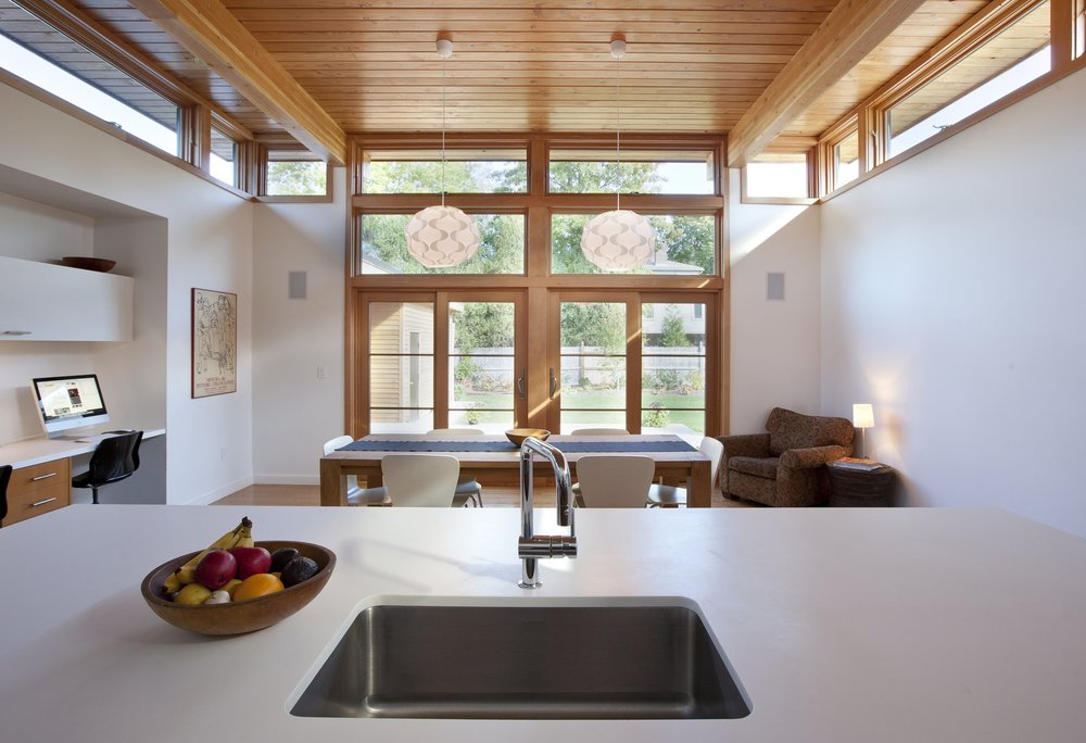 """The owners requested that the kitchen act as the center of the home so it was built at the rear of the property. """"It allowed us to pop off the roof and add clerestory windows to bring in an abundance of sunlight and fresh air,"""" DiRocco said. The sink is by Blanco and the faucet is by Grohe.  Photo: Peter Vanderwarker"""