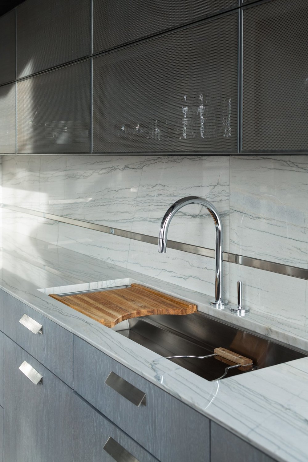 A Kallista sink and faucet abuts the back wall.  Photo: David Lauer Photography