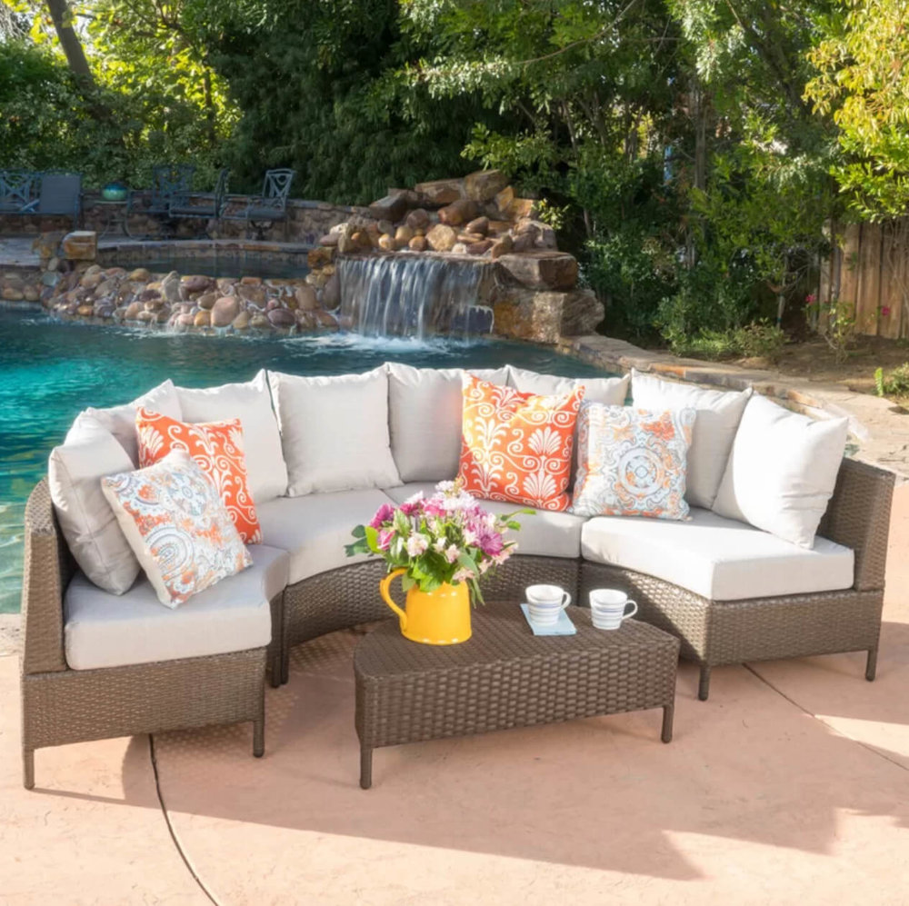 Add color to your summer entertaining with the Mercury Row Dowd Rattan Sectional Set. Image:  Wayfair