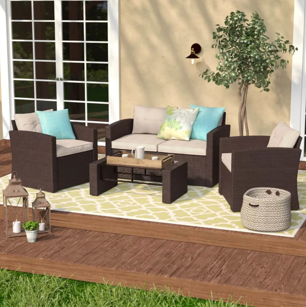 Move the party outdoors with the Raven 4-Piece Outdoor Love Seat Set. Image:  Wayfair